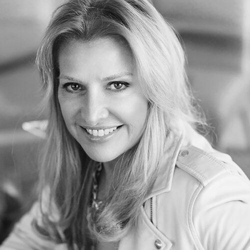 Black and white headshot photograph of Mindy Grossman.