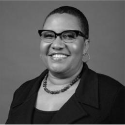 Black and white headshot photograph of Pam El.