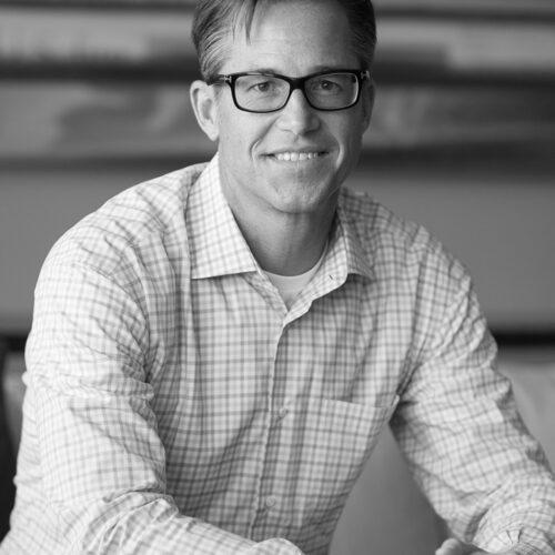 Black and white headshot photograph of Rich Barton.
