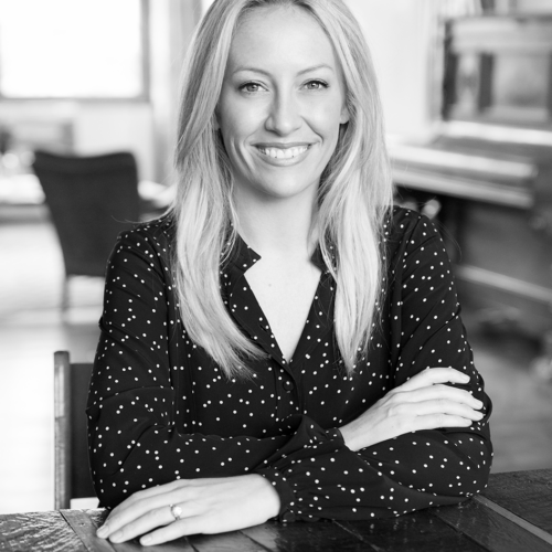 Black and white photo of Julia Hartz in an office setting.
