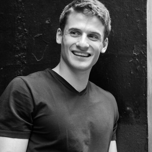 Black and white headshot of Zach Reitano.