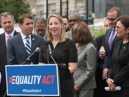 A woman speaking at a news conference about the Equality Act in 2019.